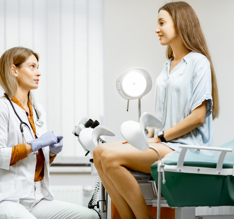 Female Gynecologist Speaking with Female Patient