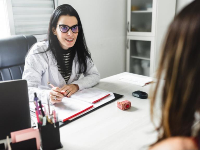 Female Dermatologist Speaking With Patient