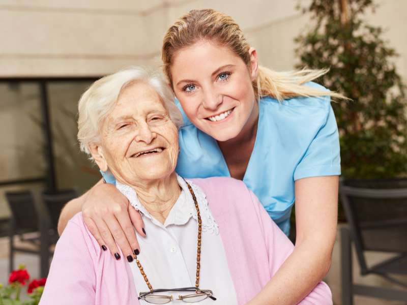 Female Geriatrician With Elderly Female Patient