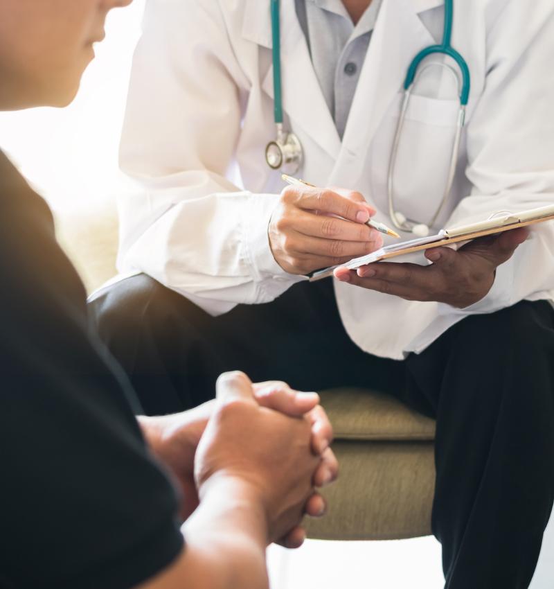 Psychiatrist Speaking with Patient