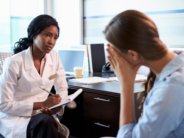 Psychiatrist with Depressed Patient