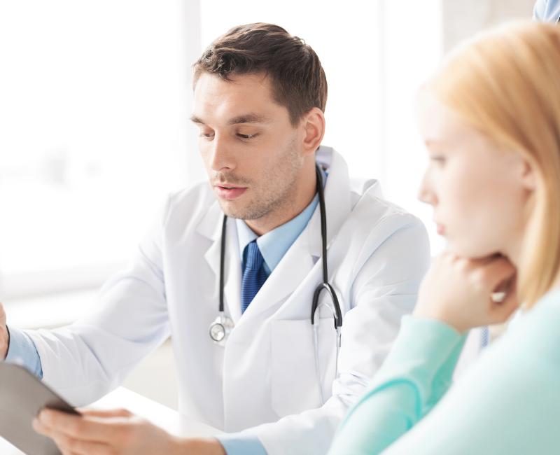 Internal Medicine Specialist Talking to Female Patient