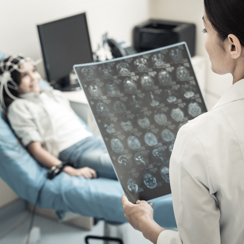Pediatric Neurologist Looking at Child's X-Rays