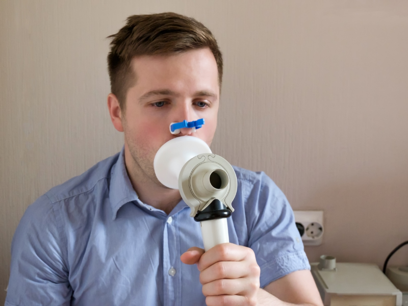 Man Using Spriometry Apparatus for Breathing Test