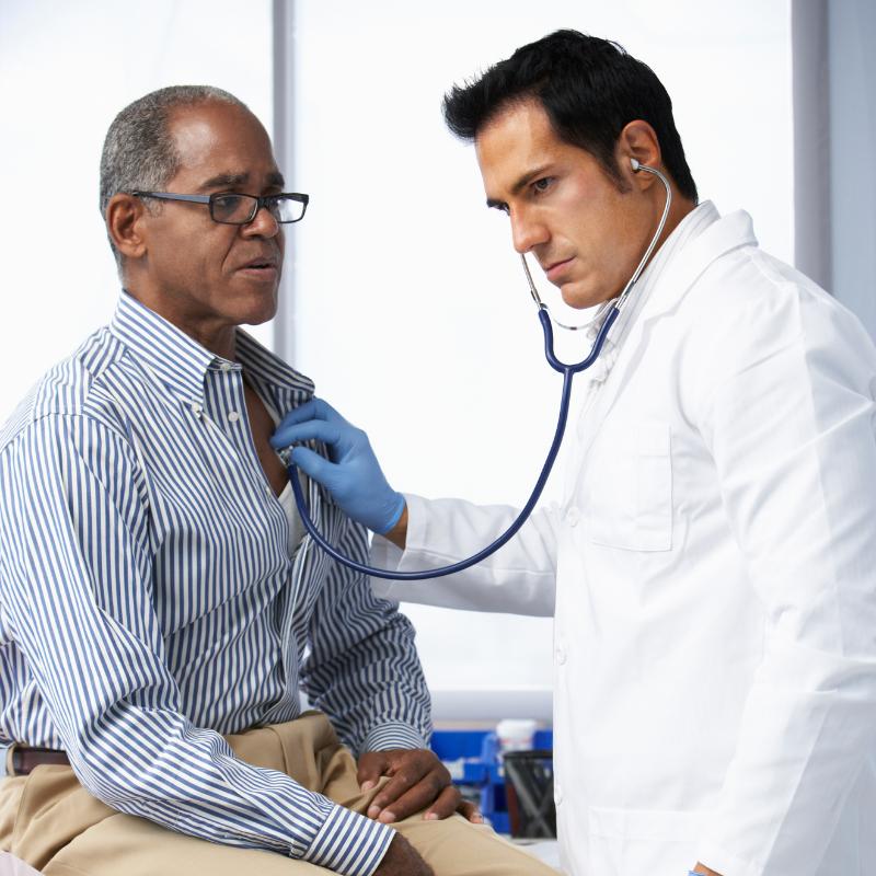 Pulmonologist Examining Breathing of Elderly Patient